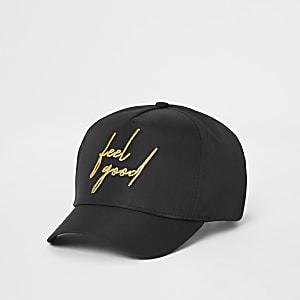 Zwarte pet met 'Feel good'-print