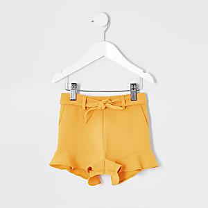 Short jaune à volants mini fille