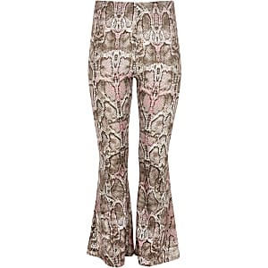 Girls pink snake print flared trousers