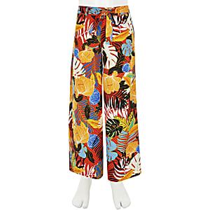 Oranje broek met tropische print en wijde pijpen voor meisjes