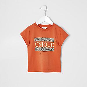 Mini - Oranje T-shirt met 'unique'-print voor meisjes