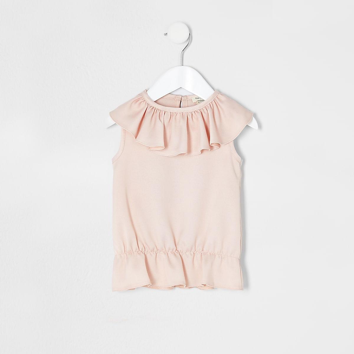 Pinkes Oberteil mit Rüschen