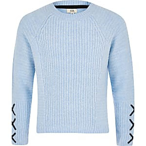 Blauwe pullover met kruisjes detail op de mouwen voor meisjes