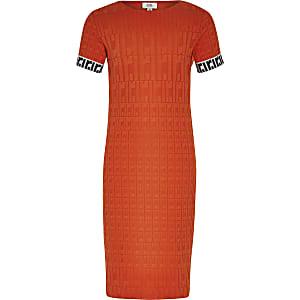 Rode jurk met RI-monogram voor meisjes