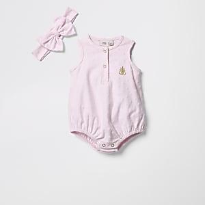 Barboteuse rose texturée avec bandeau pour bébé