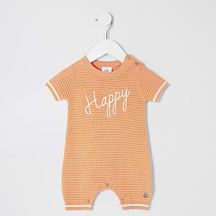 Baby orange 'Happy' knitted romper