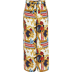 Girls cream scarf print wide leg trousers