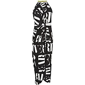 Zwart-witte maxi-jurk met overslag en RI-print voor meisjes