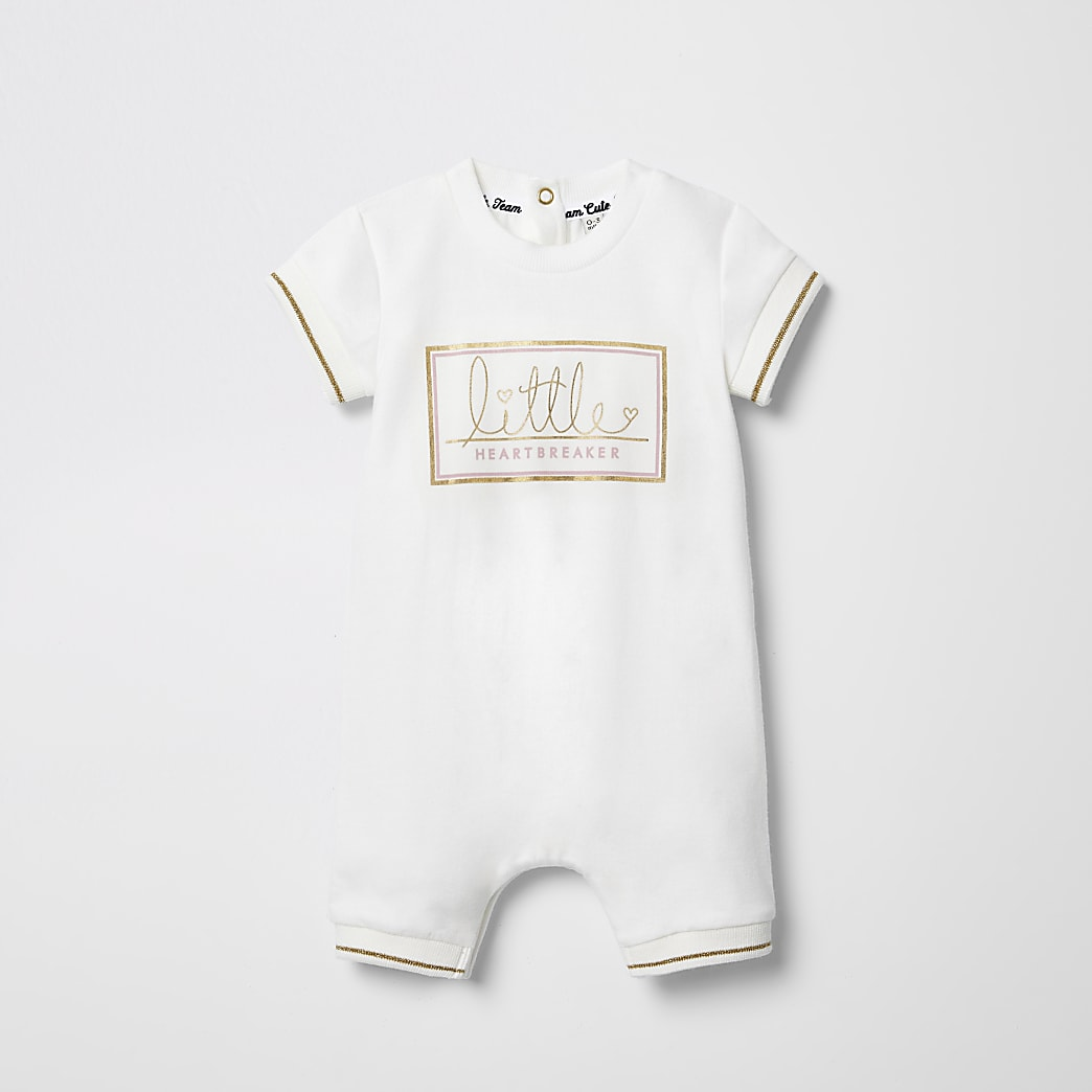 Crème rompertje met 'Little Heartbreaker'-print voor baby's