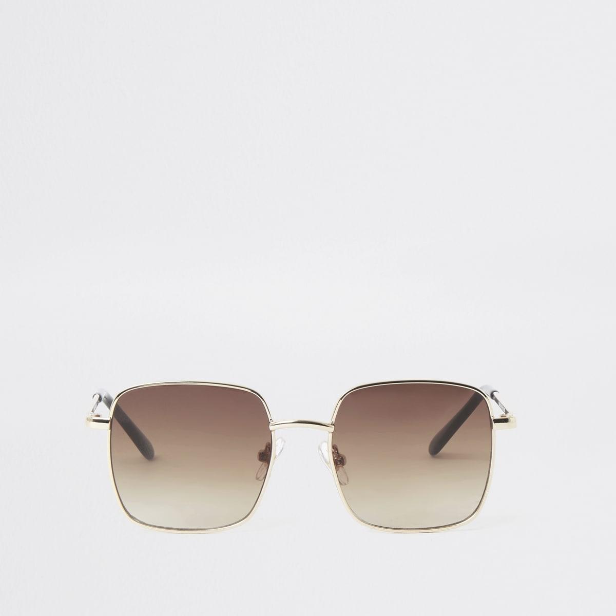 Goldfarbene Sonnenbrille mit getönten Gläsern