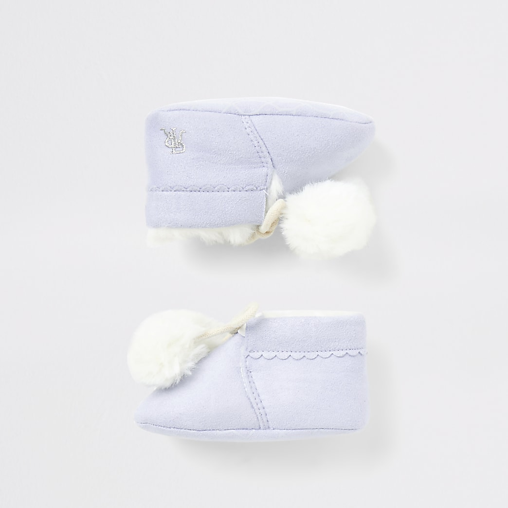 Blauwe laarsjes met pompons en gevoerd met imitatiebont voor baby's