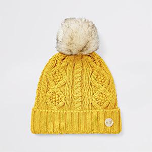 Bonnet en maille jaune à pompon pourbébé