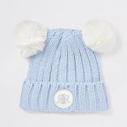 Light blue double faux fur pom beanie hat