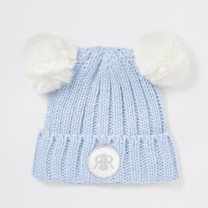 Light blue double faux fur pom beanie hat