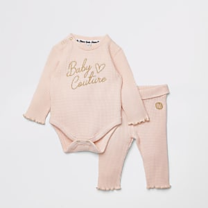 Baby pink babygrow outfit