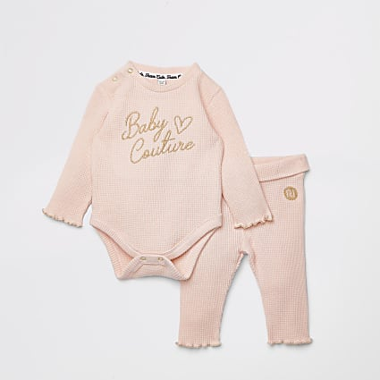 Baby pink baby grow and leggings outfit
