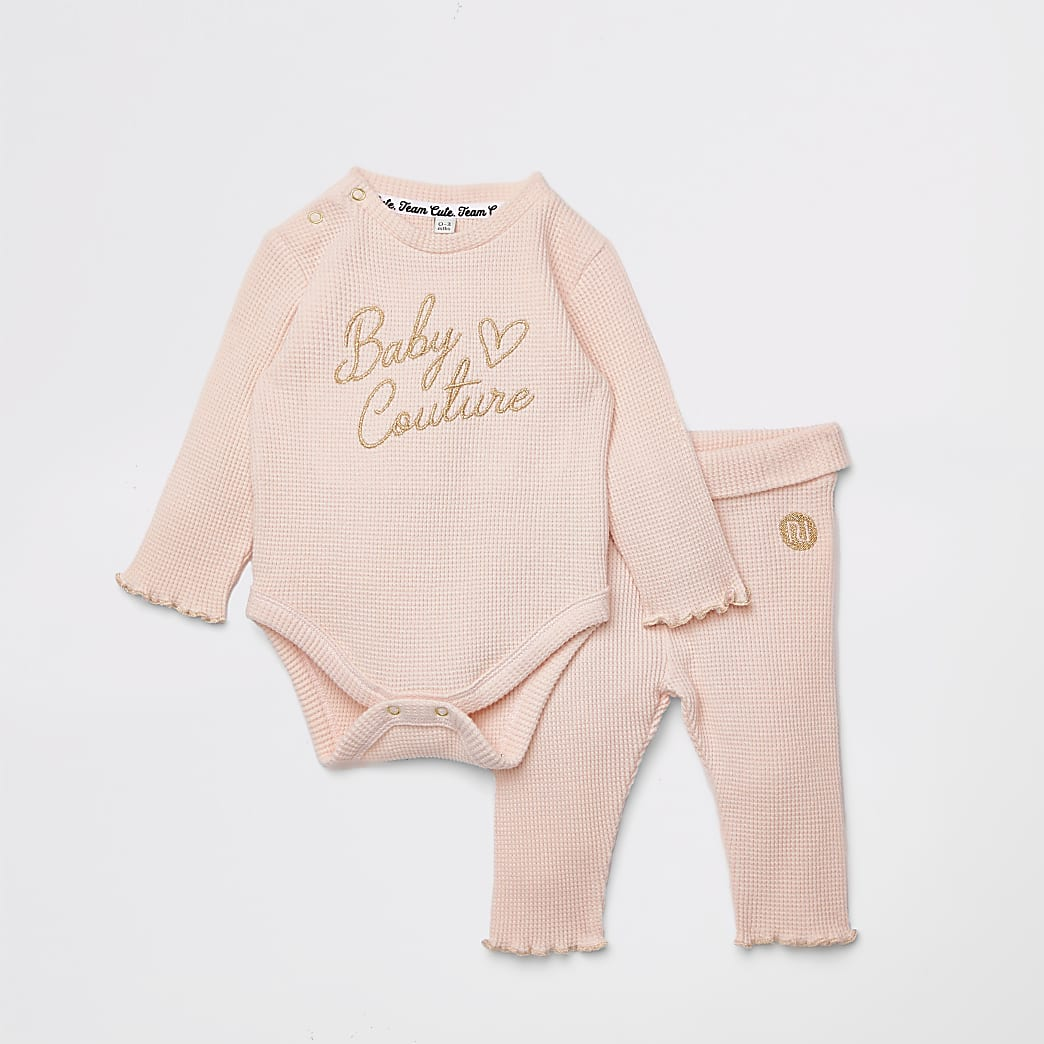 Baby pink bodysuit and leggings outfit