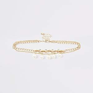 Girls gold tone pearl choker
