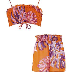 Outfit met oranje crop met koord en bloemenprint voor meisjes