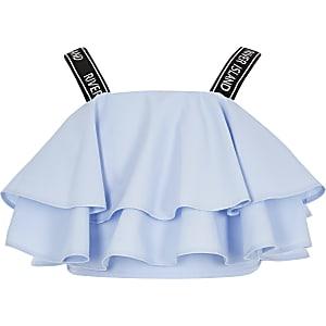 RI – Crop top à bretelles à volant bleu fille