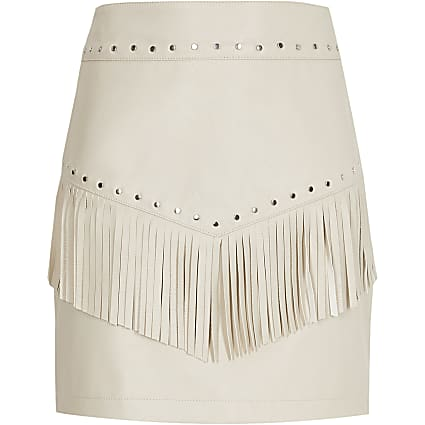 Girls cream faux leather tassel stud skirt