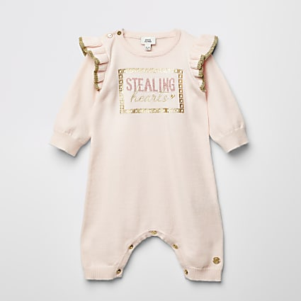 Baby pink 'Stealing hearts' knit baby grow
