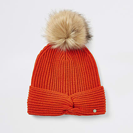 Girls red twist front faux pom pom hat