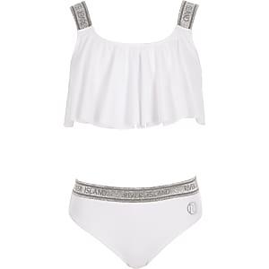 Witte bikiniset met glitters en RI-logo