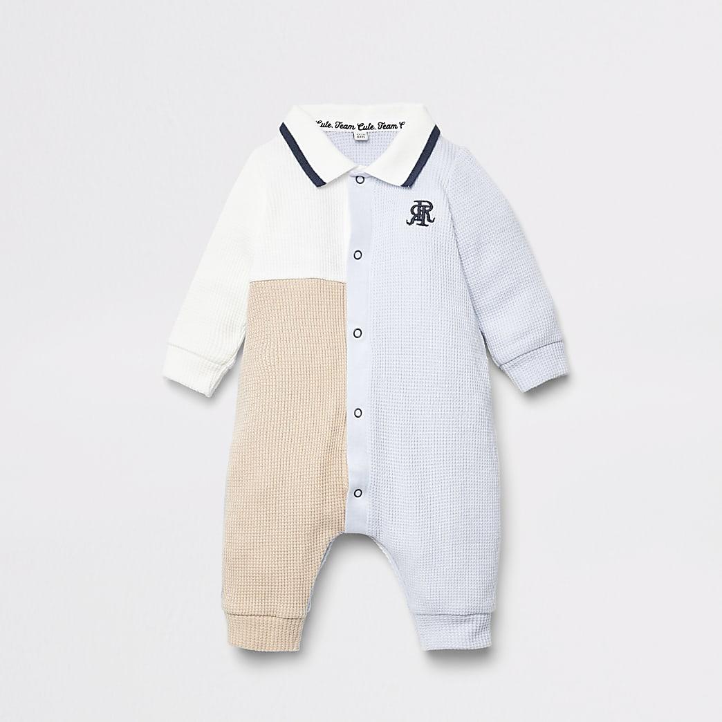 Blauw rompertje met kleurvlakken voor baby's