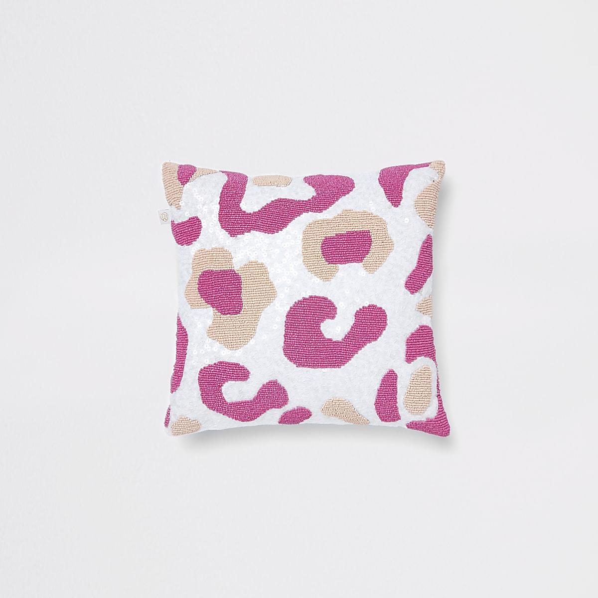 Coussin motif léopard rose et blanc à perles