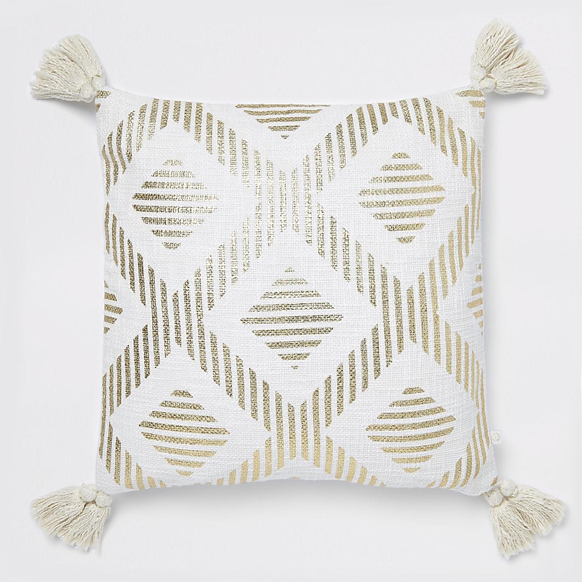 Gold print cushion with tassels