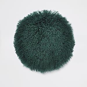 Dunkelgrünes, rundes Kissen