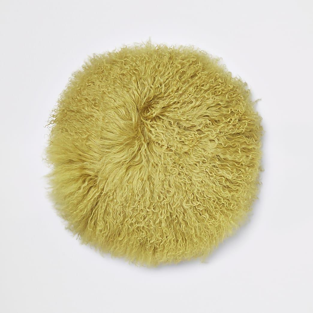 Rundes, gelbes Kissen im mongolischen Stil