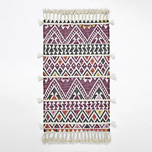 Small pink geometric multi tassel rug