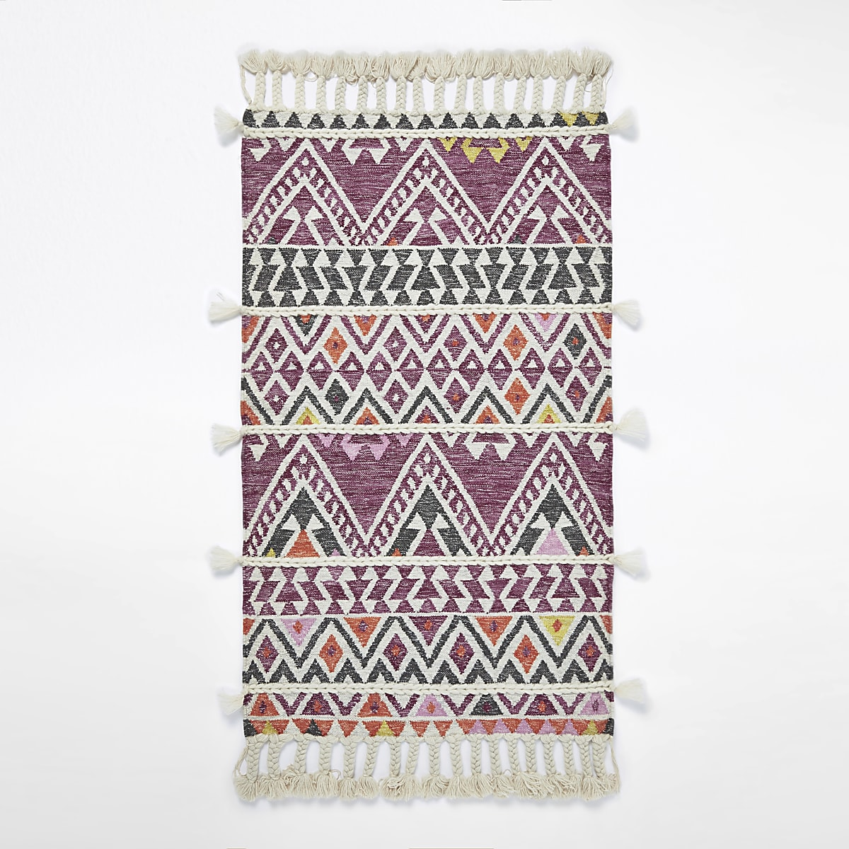 Small pink geometric multi tassel rug