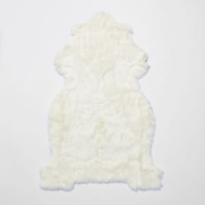 White faux fur rug with gold foil reverse