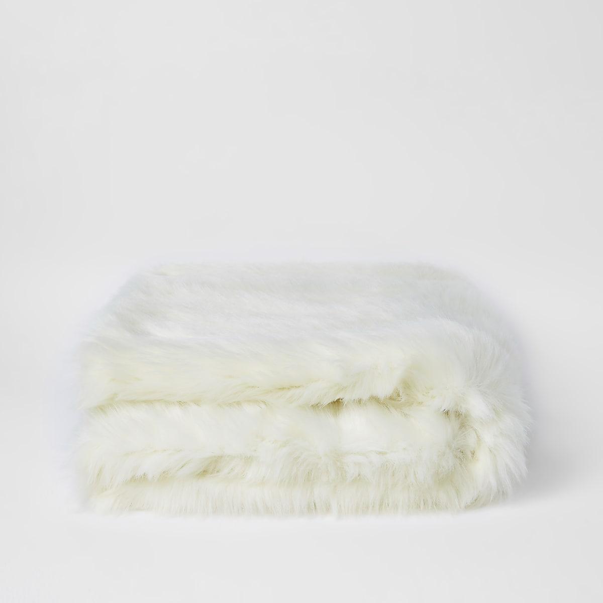 Crème sprei met imitatiebont en goudkleurige folie aan de achterkant