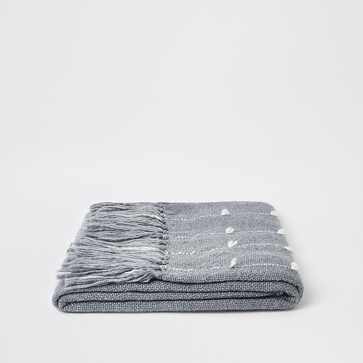 Grey throw with sewn thread detail