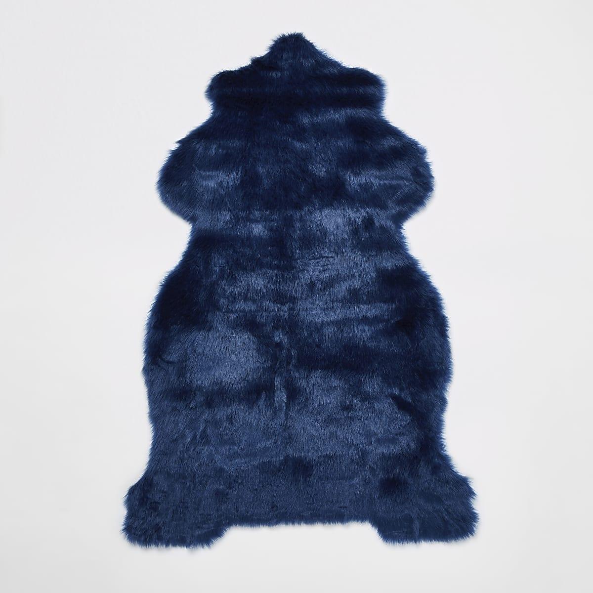 Tapis en fausse fourrure bleu à revers doré