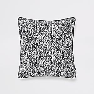 Coussin imprimé léopard noir