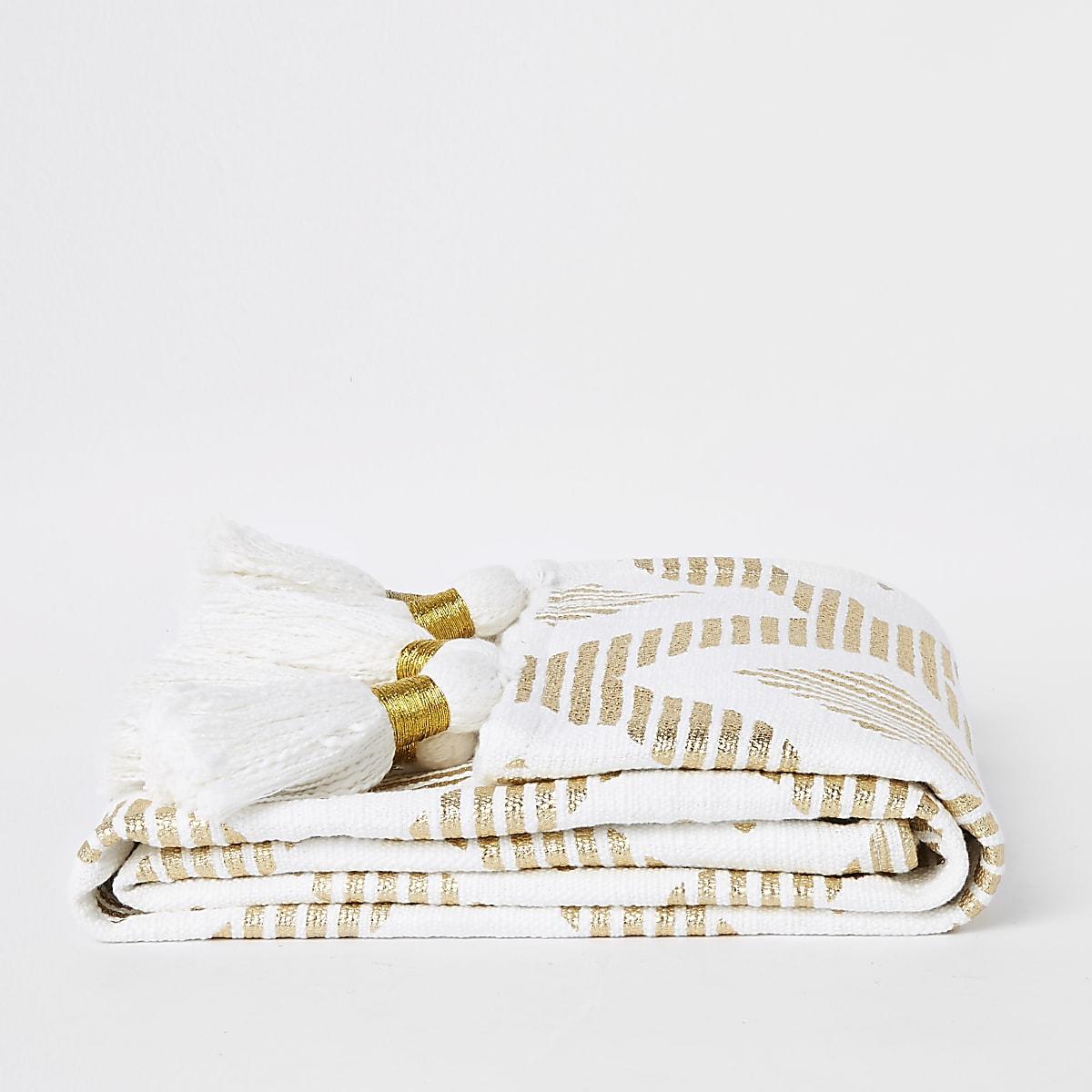 Crème plaid met goudkleurige print en kwastjes
