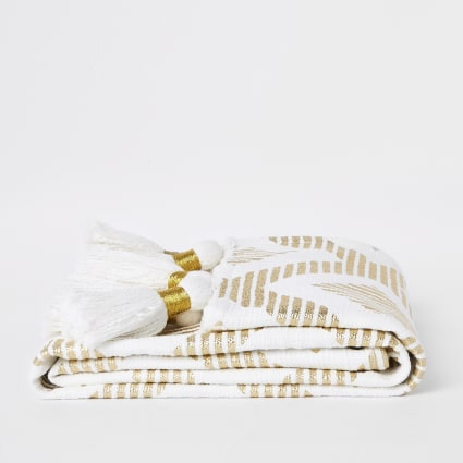 Cream and gold print throw with tassels