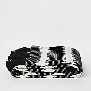 Wit met zwarte plaid met zigzagmotief en kwastjes