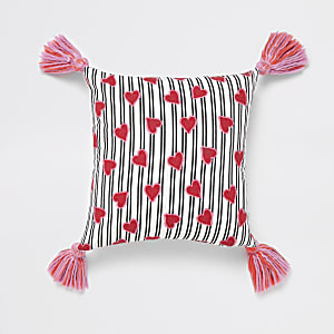White heart print cushion with tassels