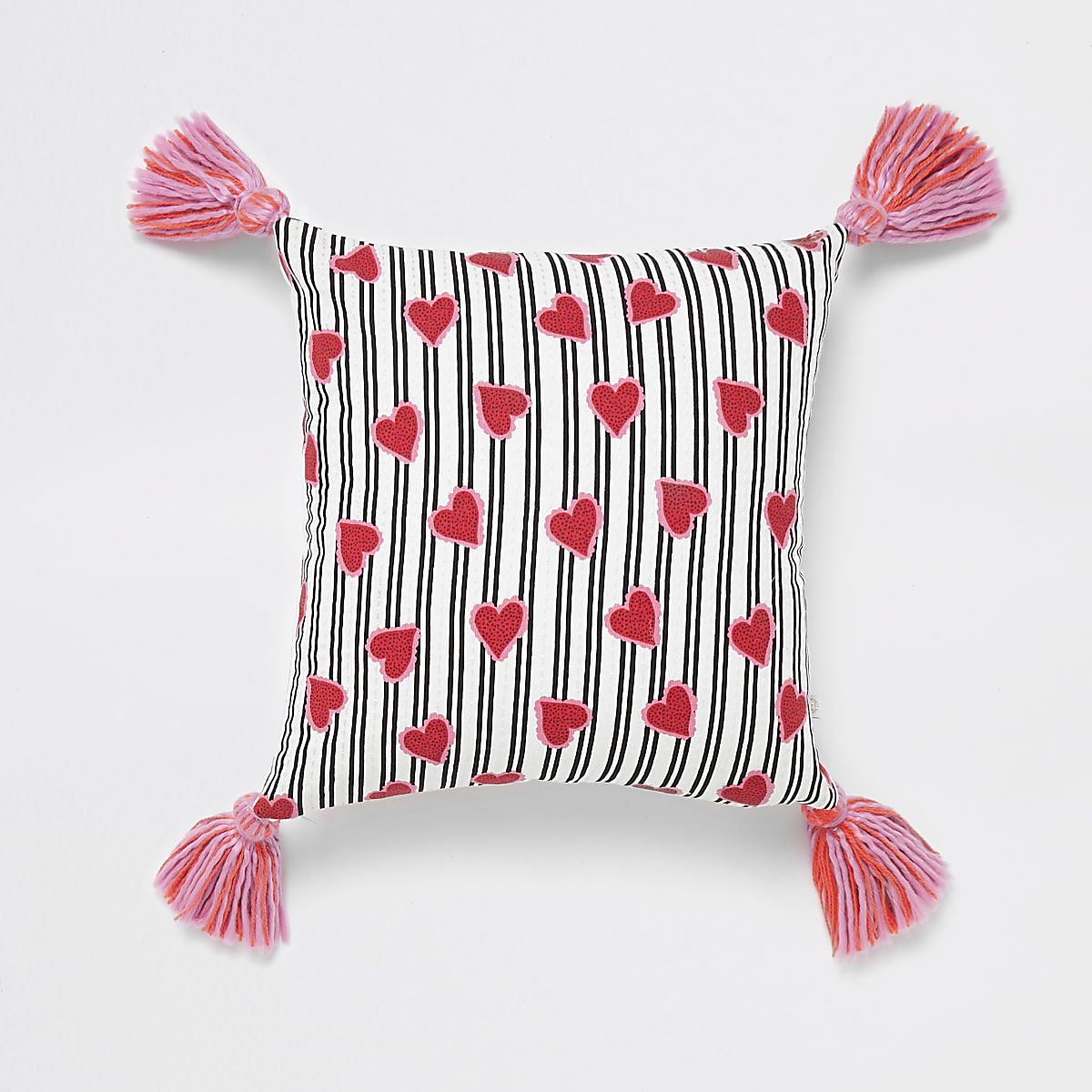 White heart print cushion with tassels