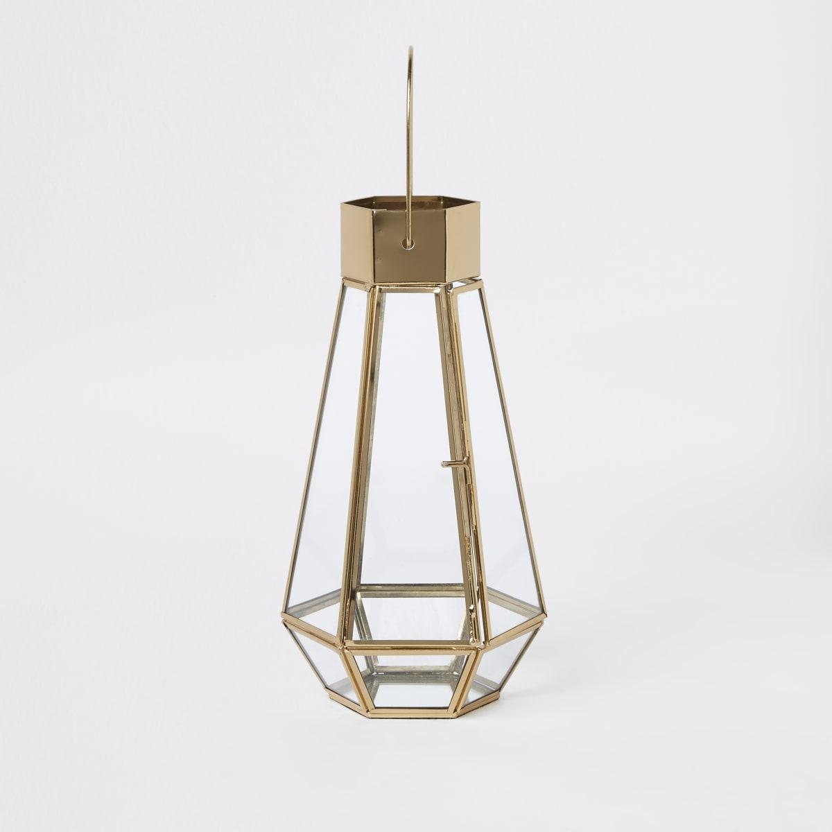 Goudkleurige grote glazen lantaarn