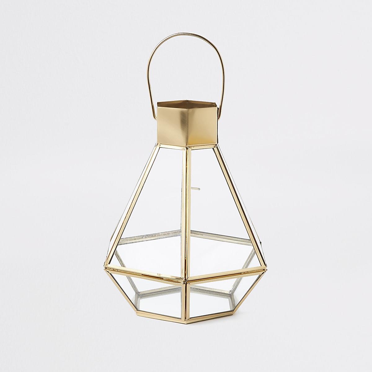 Goudkleurige kleine glazen lantaarn