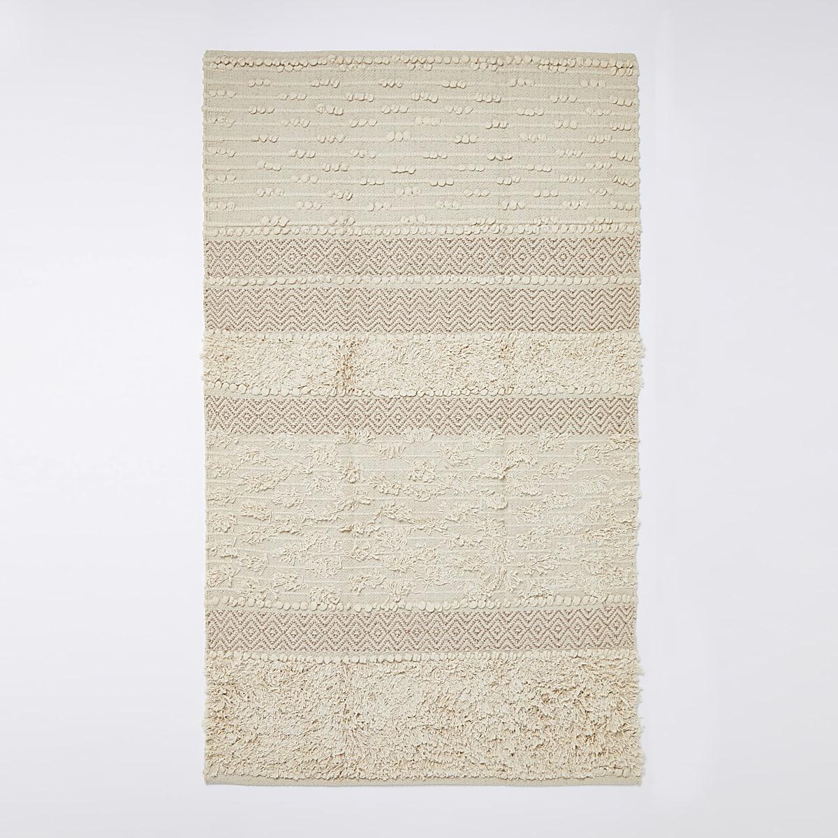 Getuft tapijt in crème en goud