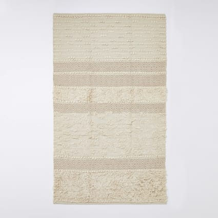 Cream and gold tufted rug