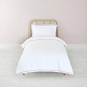 Parure de lit simple blanche à bordure rose